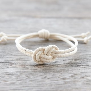 Infinity bracelet , waxed cotton cord bracelet in cream