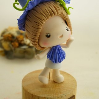 Handmade clay flower doll