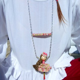 Balancing doll necklace