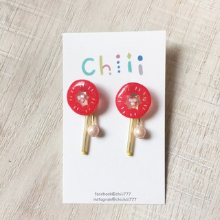 Na two clip / pin earrings