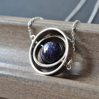 Spinning little planet with Goldstone necklace