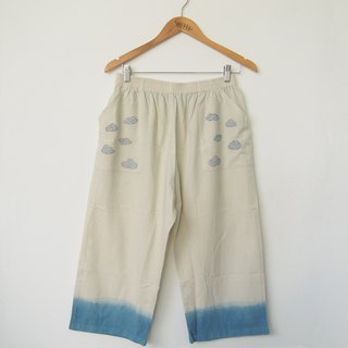 Partly cloudy wide leg pants / indigo dye with hand embroidery
