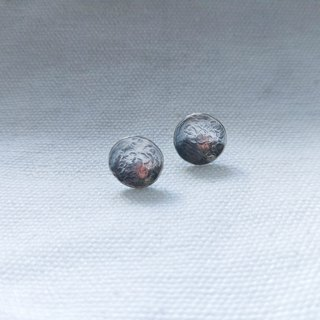 Irregularly textured vulcanized earrings