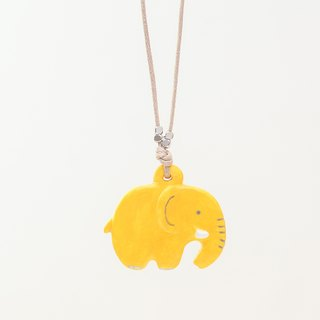 a little yellow elephant handmade necklace from Niyome clay.