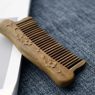 Natural hand-carved green-stemmed sandal comb