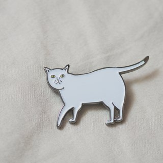 White cat with yellow eye pin