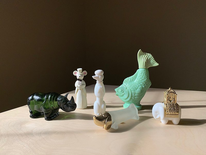 Early Avon perfume bottle/animal collection