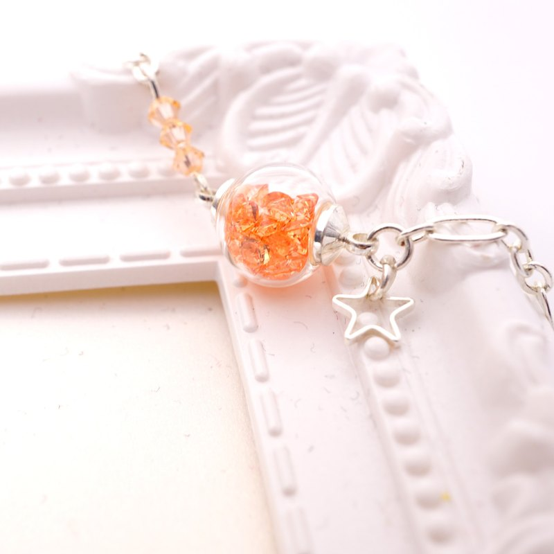 A Handmade pale orange glass beads bracelet
