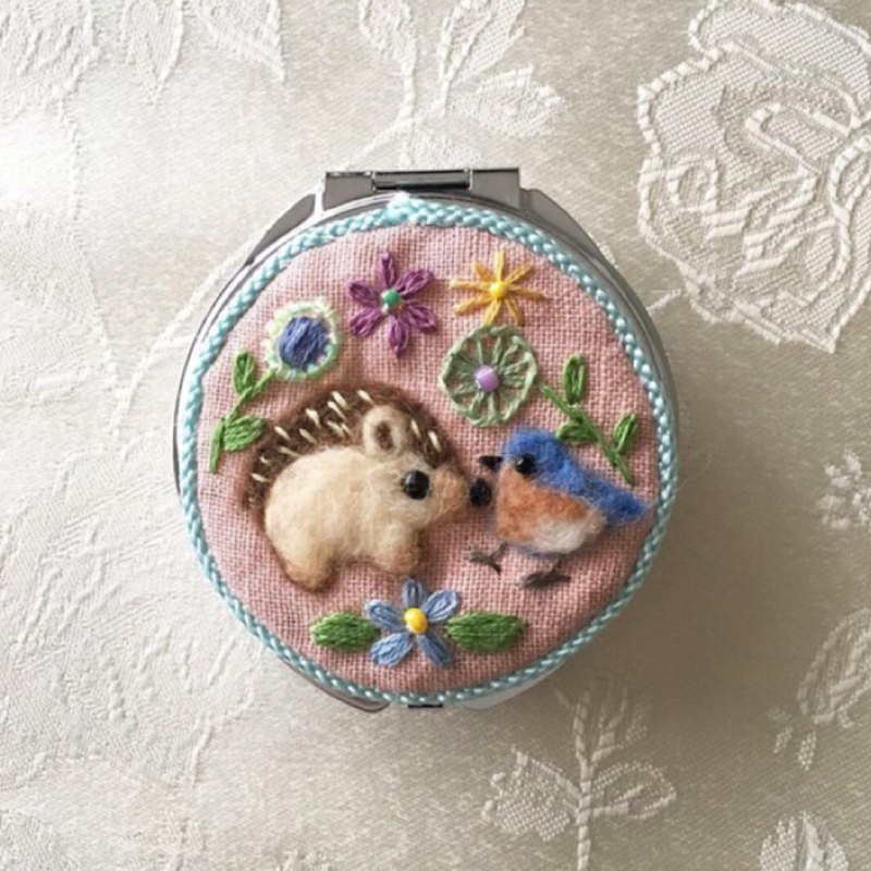 pill case of hedgehog and bluebird