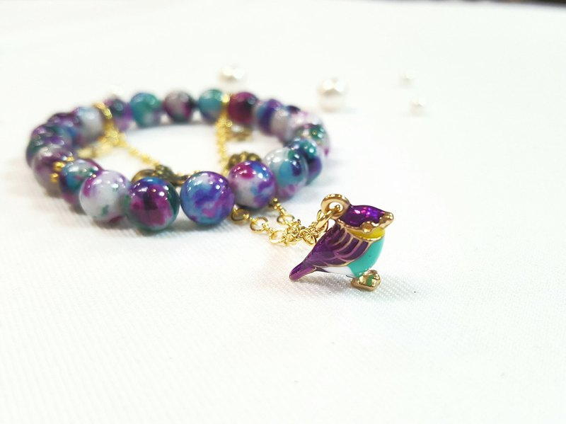 Paris*Le Bonheun. An elf (purple bird) dancing in the sky. Natural stone bracelet