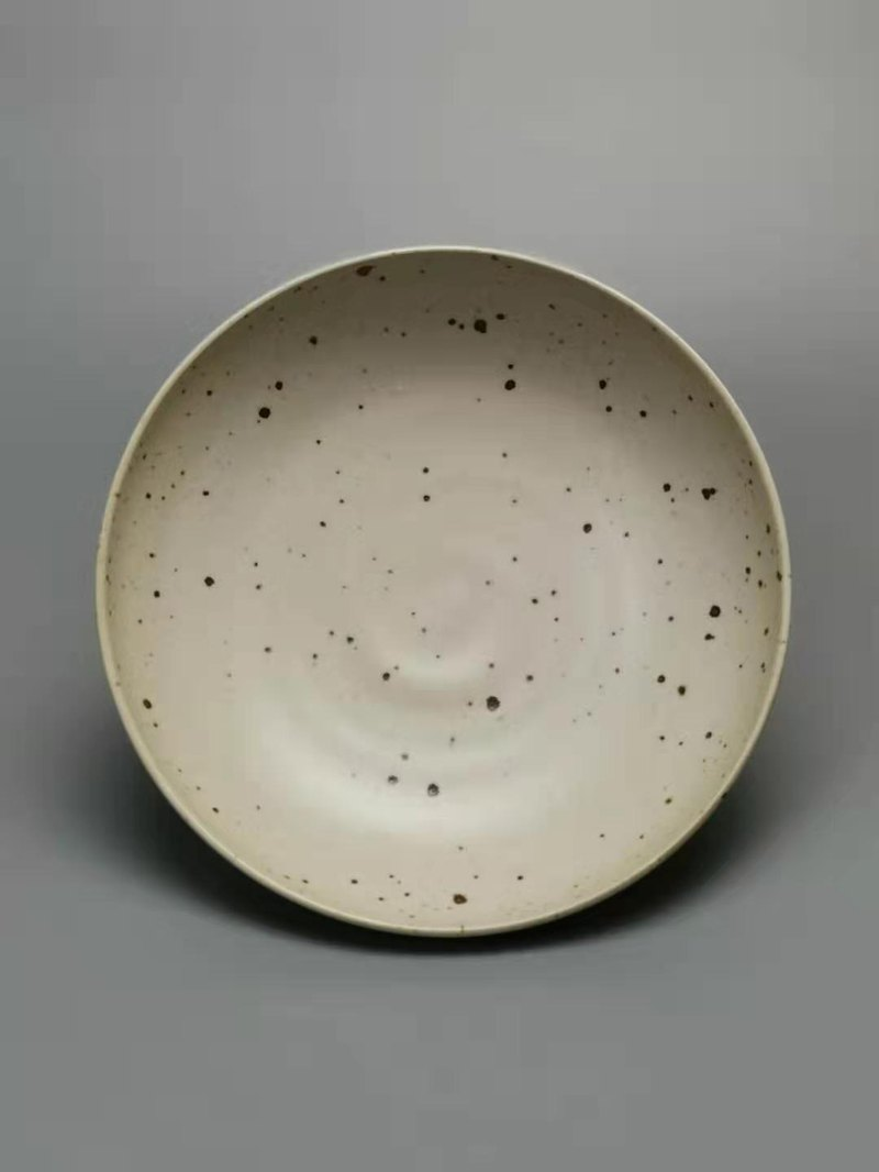 Four elephant food. Plate - handmade ceramic dishes / black spots on white