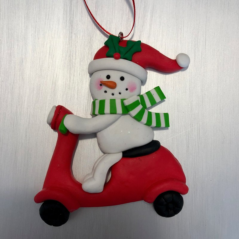 Christmas snowman riding a motorcycle charm