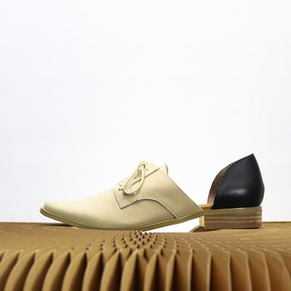 beige and black leather Hollow Oxford shoes
