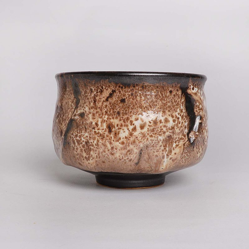 Three glazed flying fingers tea bowl