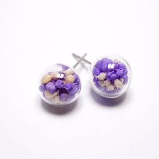 A Handmade purple glass ball earrings with white stars