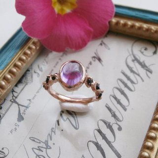 Ring of amethyst and garnet