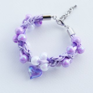 Purple beaded rope bracelet with purple heart charm