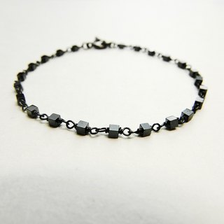 [Lalune] is a small cubic hematite 925 sterling silver black and gray bracelet