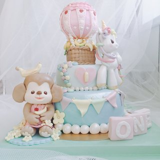 Colorful hot air balloon monkey shape turned sugar cake