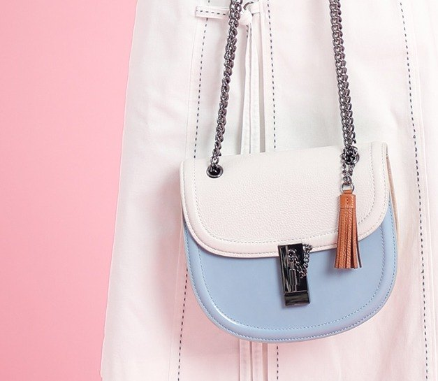 Styling buckle head sliding chain leather side backpack blue apricot spell orange tassel