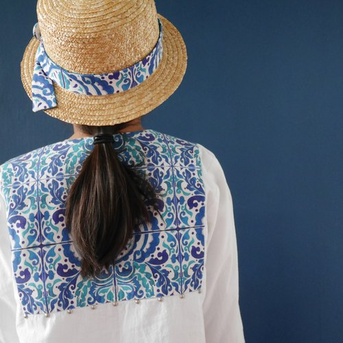 Woven straw hat with fabric hat band