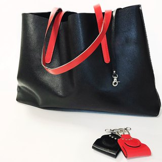 Black glossy leather tote bag with key ring