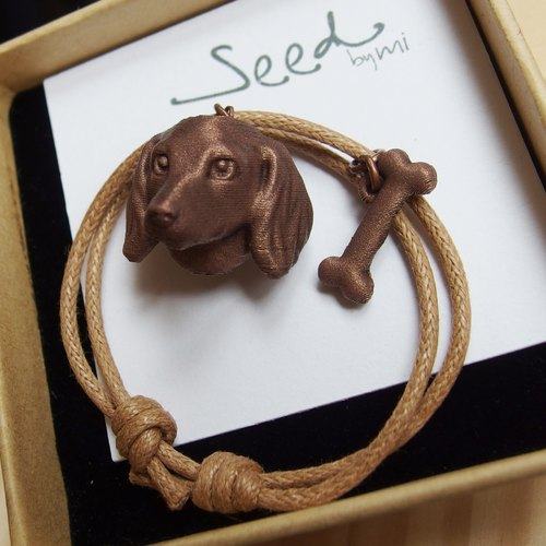 Sausage dog & bones pendant with wax wrist strap