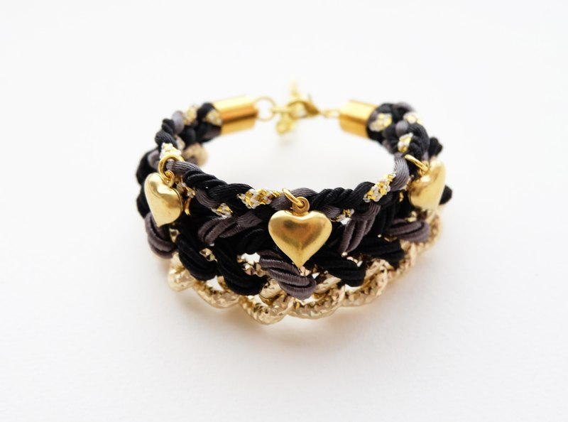 Black braided gold chain bracelet with brass heart charm