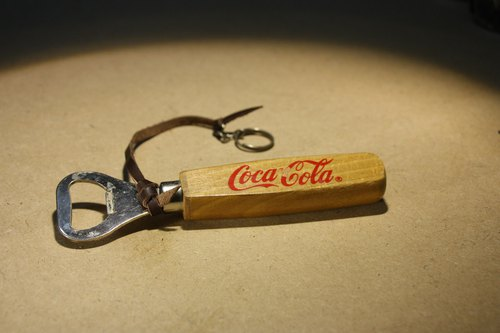 Purchased from the Netherlands COCA COLA Coca-Cola square wooden handle opener with leather cord and hanging loop