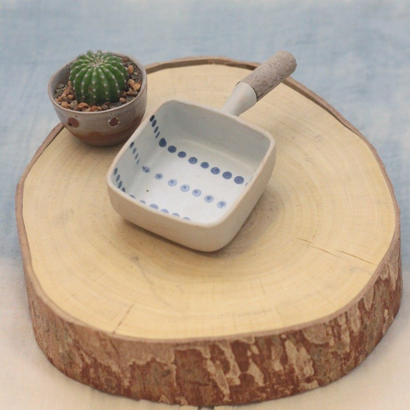 3.2.6. studio: Handmade ceramic cube bowl with wooden handle.