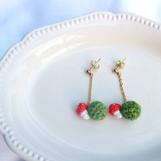 Crocheted red mushrooms with grass planet earrings