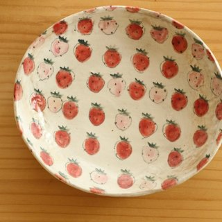 Olive dish full of dusting strawberries.