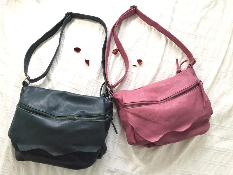 Irregularly designed cross-body bag