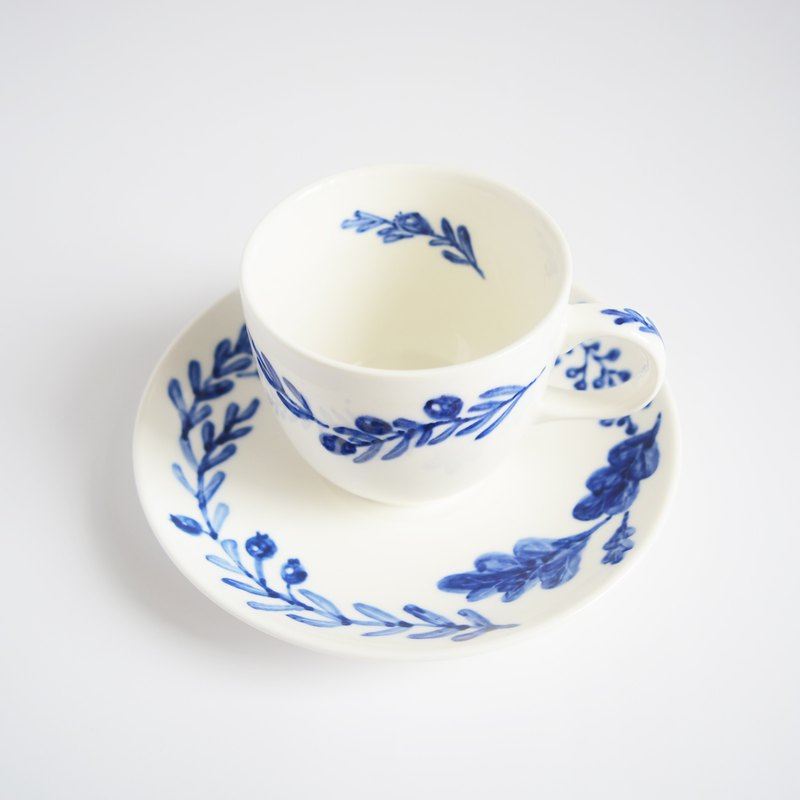 Hand-painted blue and white coffee cup fruit group
