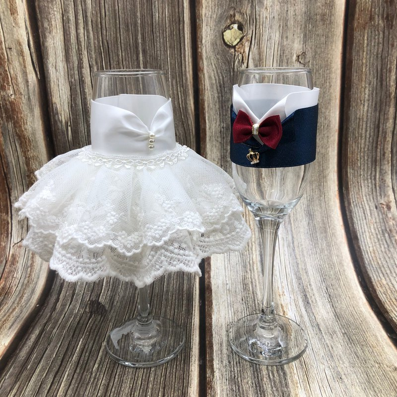 Dress styling toasting glasses champagne glasses red wine glasses wedding small things
