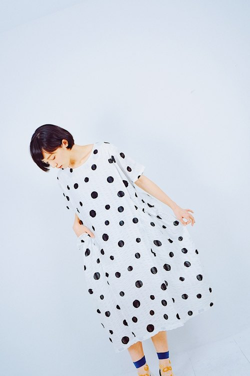 Light through the black and white dotted pocket dress