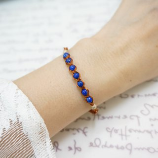 Bright veranda lapis lazuli hand around the wire braid