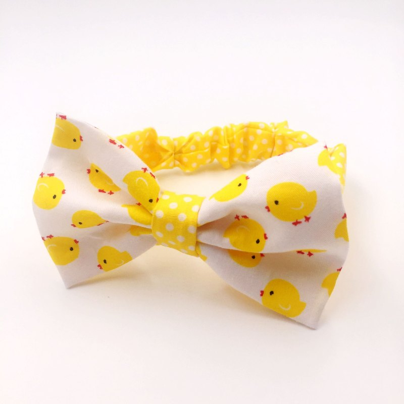 White chick with yellow dotted bow tie hairband