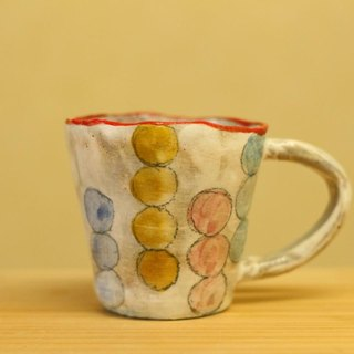 Cup of pulverized hand cup colorful dots.