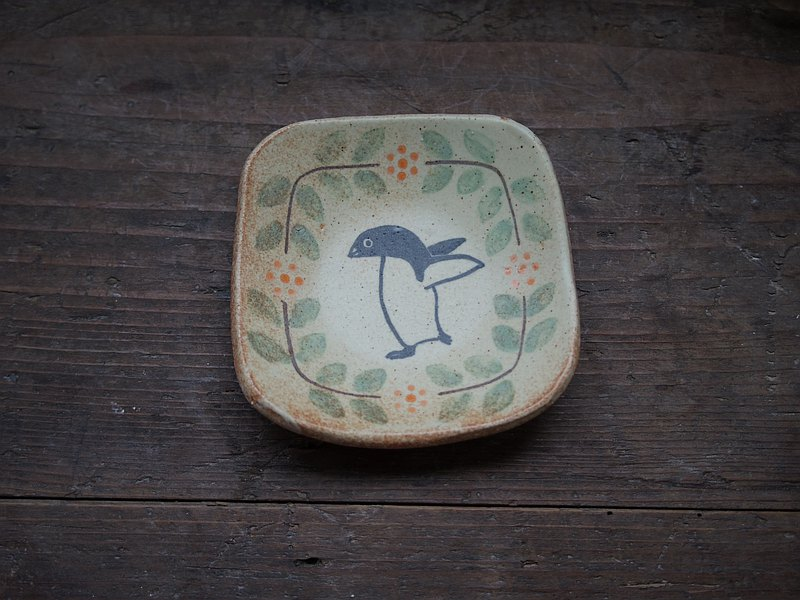 Tiny plate with Adelie penguin