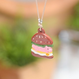The special hamburger with alive pig handmade necklace from Niyome Clay.