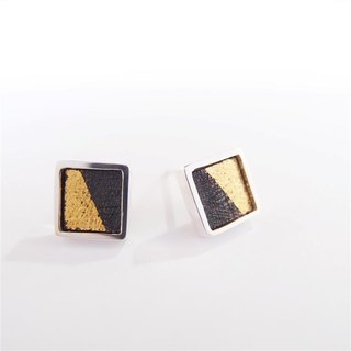 A centimeter square A-925 silver earring on the ear