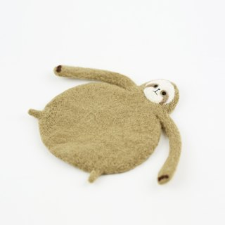 Flattened sloth wool felting coaster