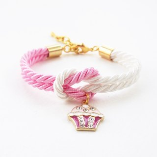 Pink and white knot bracelet with cupcake charm