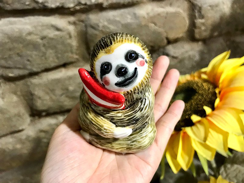 Sloth wants to sleep and heal the pottery doll