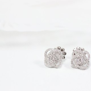 Diamond earrings with petal halo