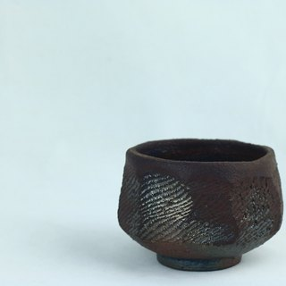 Iron-like wood burning tea bowl