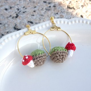 Crocheted little red mushrooms with grass globe loop gold buckle earrings