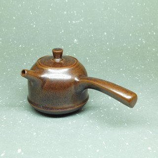 Iron glaze gun mouth bell side of the teapot hand pottery tea props