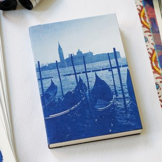 Hand sun and blue notebook - gondola